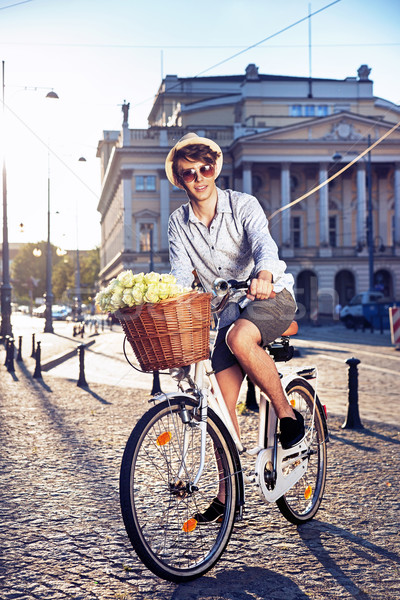 Elegant man riding a bike Stock photo © konradbak