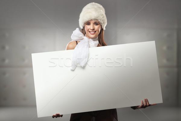 Young happy woman over white board Stock photo © konradbak