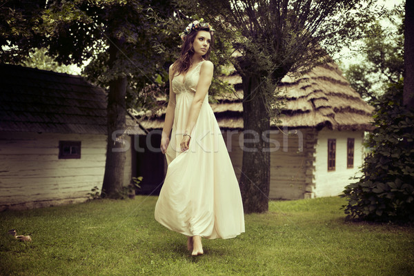 Lady in white dress dancing on the grass Stock photo © konradbak