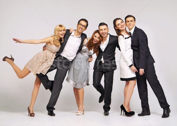 Group of laughing friends in fancy pose Stock photo © konradbak