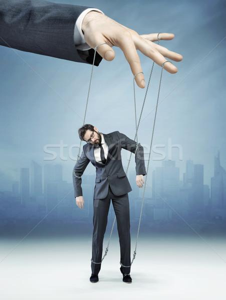 Conceptual picture of controlled employee Stock photo © konradbak