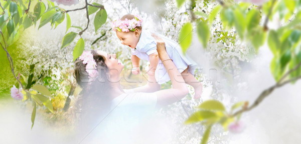 Pretty mother and her little baby relaxing in a spring orchard Stock photo © konradbak