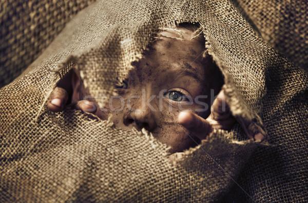 Kicsi hajléktalan fiú visel táska gyermek Stock fotó © konradbak