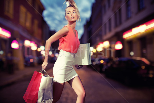 Smiling girl with shopping bags Stock photo © konradbak
