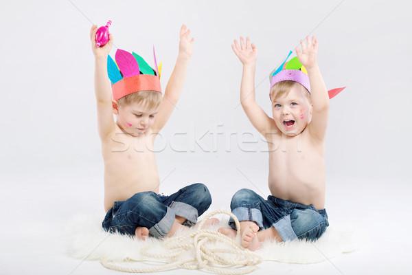 Funny picture of two boys playing Indians Stock photo © konradbak