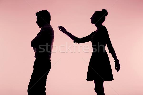 Woman trying to apologize her boyfriend Stock photo © konradbak