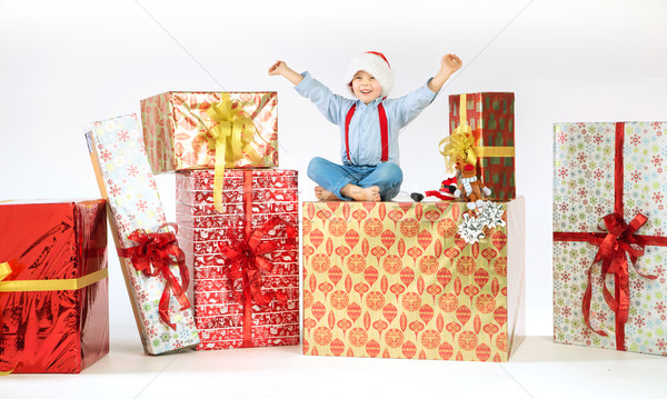 Small cute boy on plenty of presents Stock photo © konradbak