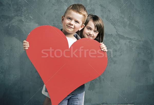 Erkek kız oyuncak kalp kâğıt Stok fotoğraf © konradbak
