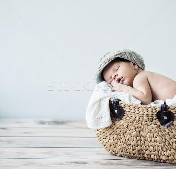 Cute tot sleeping in a basket Stock photo © konradbak