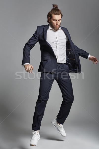 Portrait of an attractive guy wearing sports suit Stock photo © konradbak