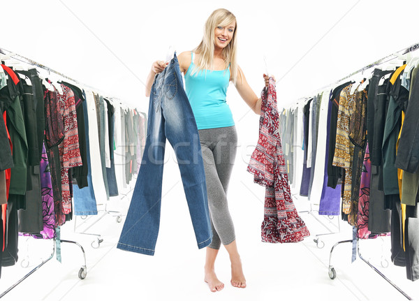 Young pretty blonde choosing what to put on Stock photo © konradbak