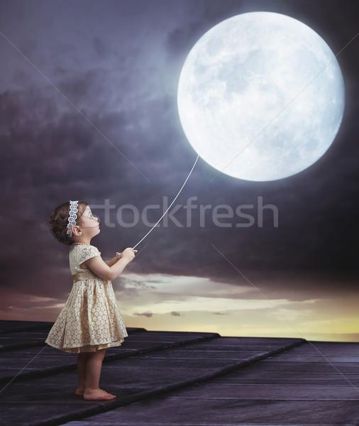 Fairy portait of a little girl with a moony balloon Stock photo © konradbak