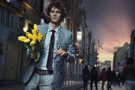 Vonzó fickó köteg tulipánok város divat Stock fotó © konradbak