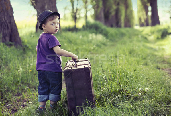 Little man leaving home with huge luggage Stock photo © konradbak