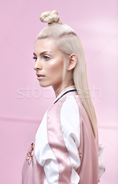 Portrait of a young lady with a fabulous coiffure Stock photo © konradbak