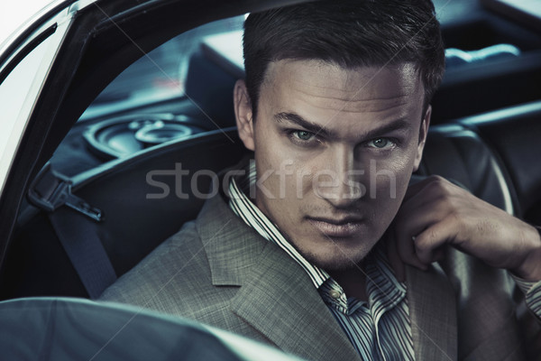 Stock photo: Portrait of a sexy man in the car