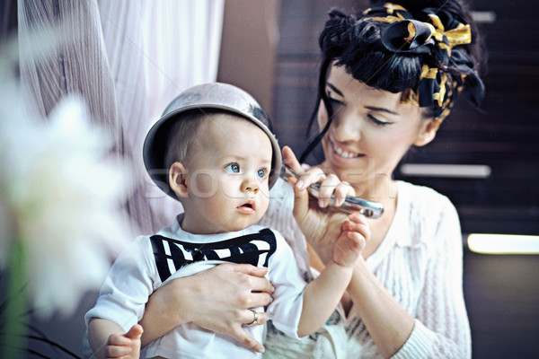 Beauty woman and baby with saucepan Stock photo © konradbak