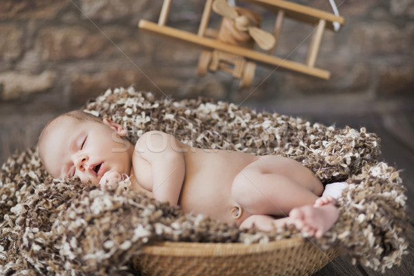 Fine picture of baby sleeping in toy room Stock photo © konradbak