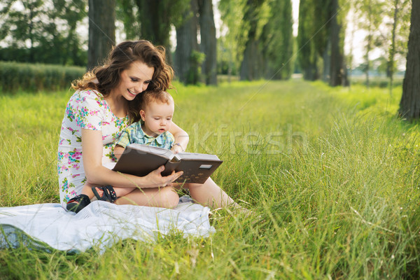 Brunette  mother reading tales for her child Stock photo © konradbak
