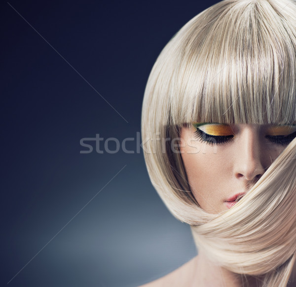 Portrait of a blond lady with trendy coiffure Stock photo © konradbak