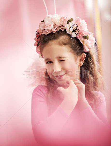 Adorable cute girl with a colorful chaplet Stock photo © konradbak