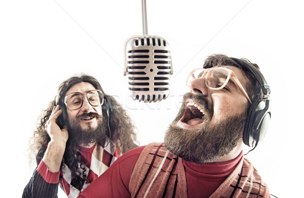 Two friends singing a karaoke Stock photo © konradbak