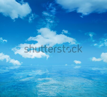 Infinite water surface over blue sky background Stock photo © konradbak