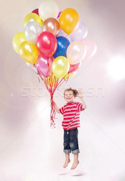 Cute small kid hovering by the ballons Stock photo © konradbak