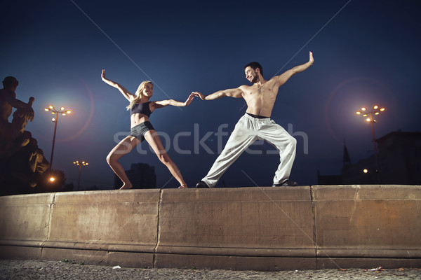 Two athletes practising in the night Stock photo © konradbak