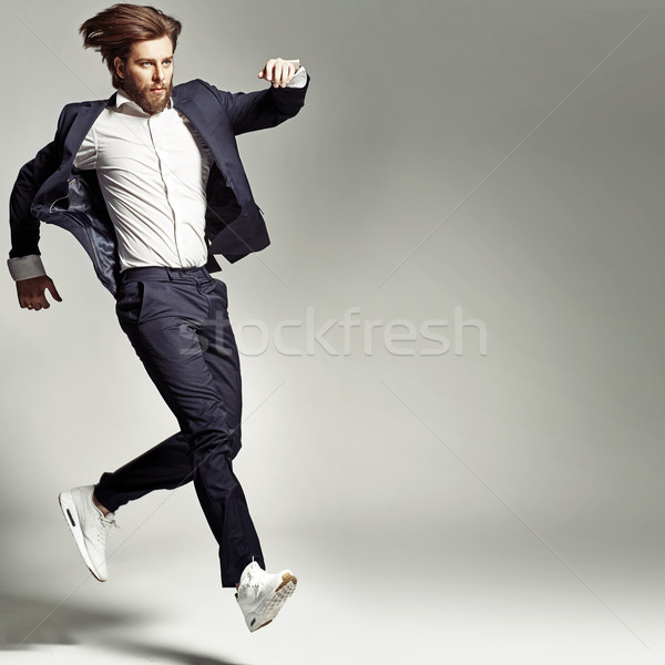 Young energetic man wearing suit Stock photo © konradbak