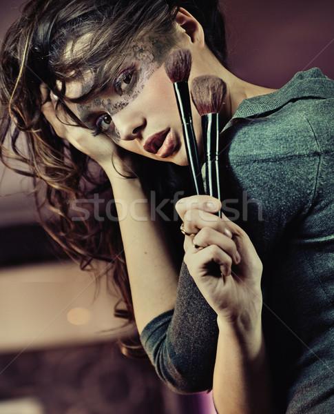 Portrait of a cute brunette Stock photo © konradbak