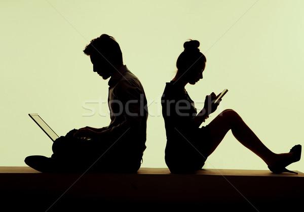 Young smart couple growing away Stock photo © konradbak