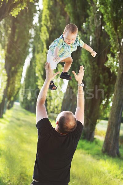 Protective father playing with son Stock photo © konradbak