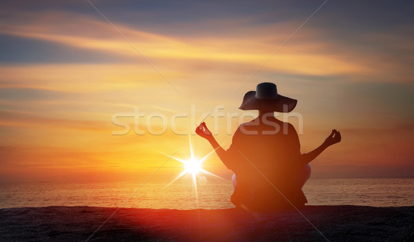 Relaxed woman meditating on a tropical beach Stock photo © konradbak