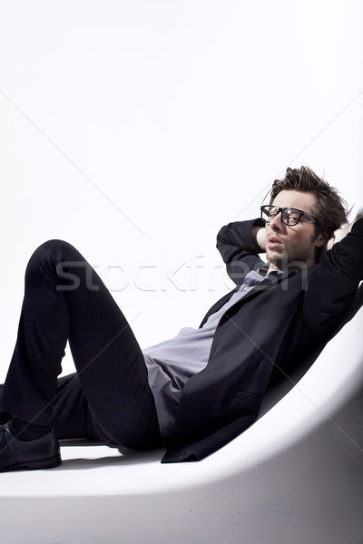 Very attractive young man relaxing in his place Stock photo © konradbak