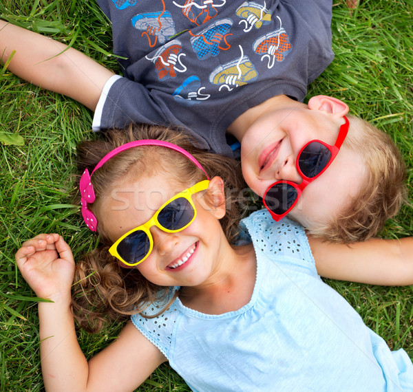 Picture presenting kids relaxinng on the grass Stock photo © konradbak