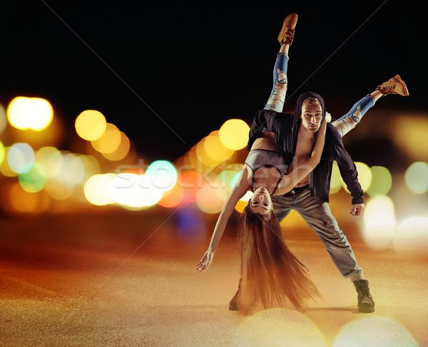 Tough hip hop guy dancing with his girlfriend Stock photo © konradbak
