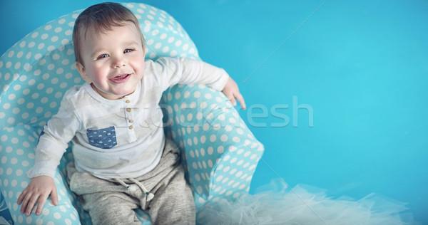 радостный мало человека сидят удобный кресло Сток-фото © konradbak