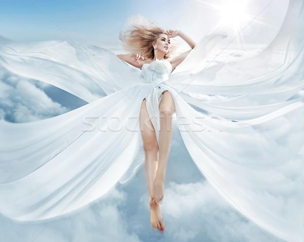 Portrait of a flying blond nymph Stock photo © konradbak