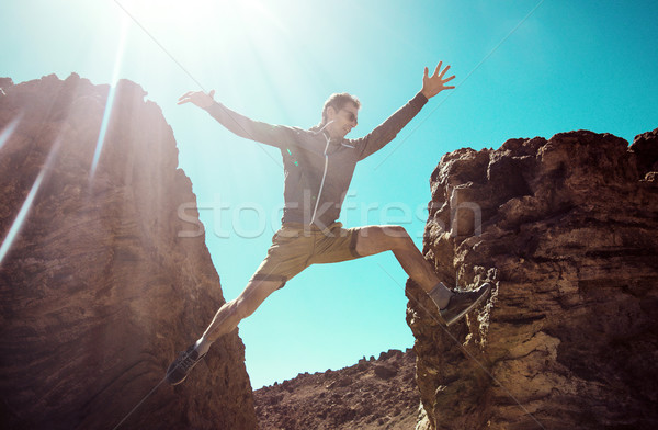 Man running on the desert mountains Stock photo © konradbak