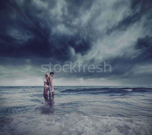 Hugging lovers in the sea Stock photo © konradbak