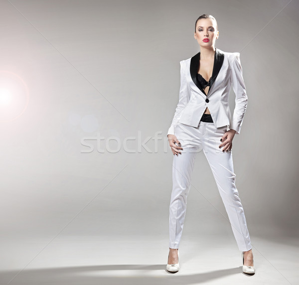 Young fashionable lady posing Stock photo © konradbak