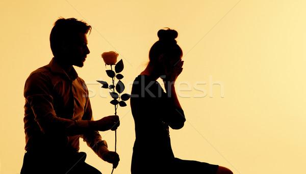 Man trying to apologize his wife Stock photo © konradbak