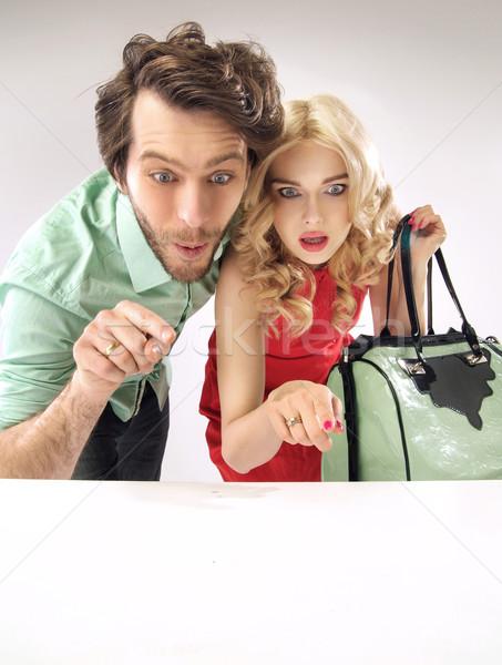 Amazed couple staring at sales Stock photo © konradbak