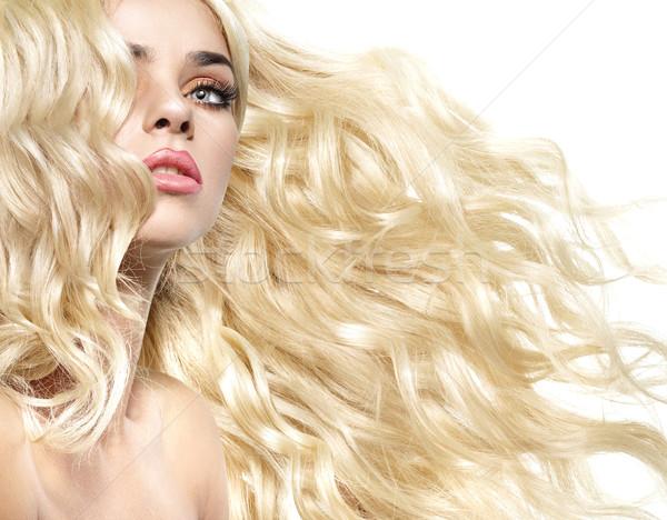 Portrait of the lady with curly and bushy hairstyle Stock photo © konradbak