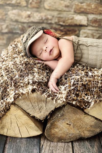 Little child sleepieng on the piece of wood Stock photo © konradbak