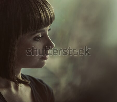 Portrait of a nostalgic brunette lady Stock photo © konradbak