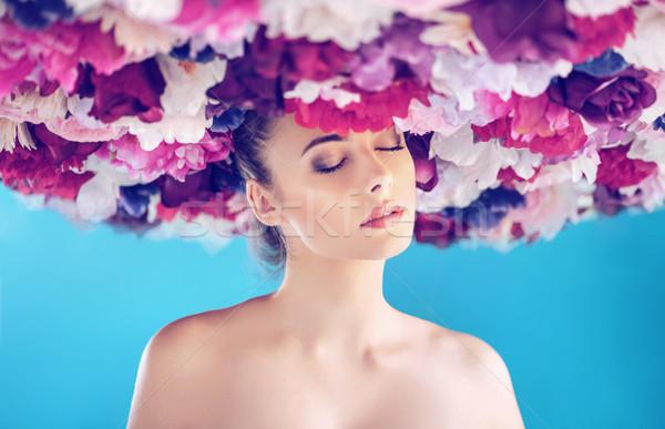 Calm pretty lady wearing a chaplet Stock photo © konradbak