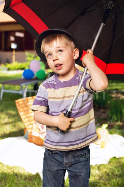 Curious boy with big umbrella Stock photo © konradbak