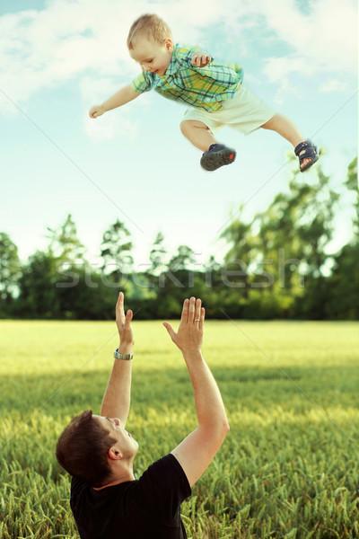 Father playing with his son Stock photo © konradbak